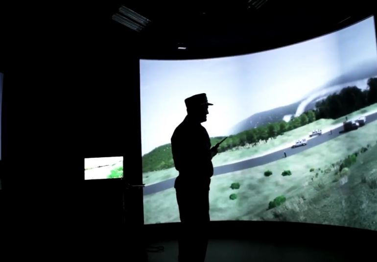 The simulator features an immersion room with 3m by 8m screen display