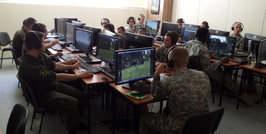 Soldiers from the US and Poland train using VBS3.